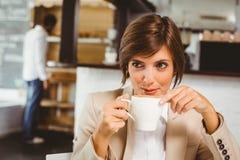 Pretty businesswoman enjoying her coffee Royalty Free Stock Photo