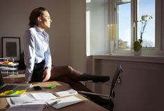 Pretty businesswoman enjoying the sun Royalty Free Stock Image