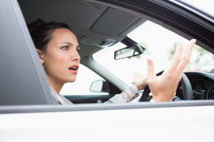 Pretty businesswoman experiencing road rage Stock Photos