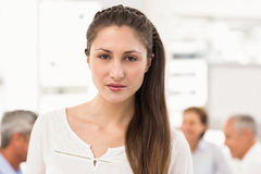 Pretty businesswoman in front of her colleagues Royalty Free Stock Images