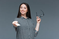 Pretty businesswoman giving blank card at camera Royalty Free Stock Photo