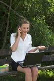 Pretty businesswoman; good news Stock Photography