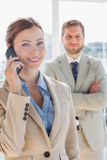 Pretty businesswoman having phone conversation Stock Images