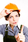 Pretty businesswoman with  helmet pointing. Stock Photo