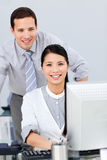 Pretty businesswoman and her colleague working Royalty Free Stock Images
