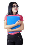 Pretty businesswoman holding folders Royalty Free Stock Images