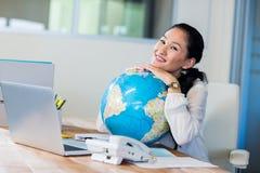 Pretty businesswoman holding globe Stock Photos