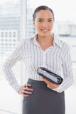 Pretty businesswoman holding her appointment calendar Stock Photography