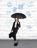 Pretty businesswoman holding umbrella Royalty Free Stock Photography