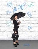 Pretty businesswoman holding umbrella Royalty Free Stock Image