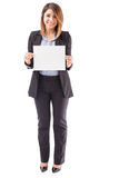 Pretty businesswoman holding up a sign Royalty Free Stock Image