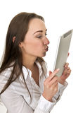 businesswoman kissing tablet pc Stock Photography