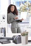 Pretty businesswoman with laptop smiling Stock Photography