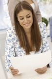 Pretty businesswoman looking at papers smiling Stock Photos