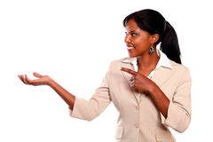 Pretty businesswoman looking and pointing right Stock Photography