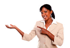 Pretty businesswoman looking at you pointing right Royalty Free Stock Image