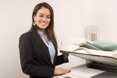 Pretty businesswoman making copies Royalty Free Stock Photos