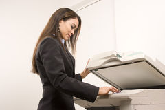 Pretty businesswoman making copies Royalty Free Stock Image