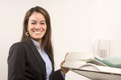 Pretty businesswoman making copies Stock Image