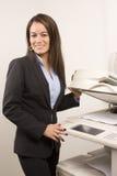 Pretty businesswoman making copies Stock Photos