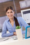 Pretty businesswoman in office Stock Photo