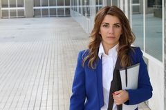 Pretty businesswoman outside the office building.  royalty free stock photos