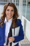 Pretty businesswoman outside the office building.  royalty free stock images