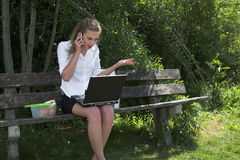 Pretty businesswoman in the park Royalty Free Stock Photo