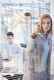 Pretty businesswoman peeping through blind Royalty Free Stock Photos