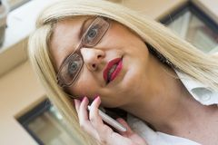 Pretty businesswoman on the phone Stock Images