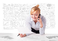 Pretty businesswoman planning and calculating various business i Stock Photography