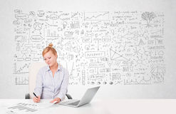 Pretty businesswoman planning and calculating various business i Royalty Free Stock Photography