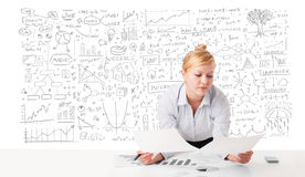 Pretty businesswoman planning and calculating various business i Royalty Free Stock Image