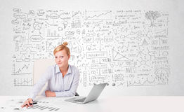 Pretty businesswoman planning and calculating various business i Stock Photo