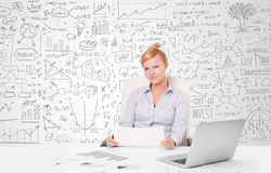 Pretty businesswoman planning and calculating various business i Royalty Free Stock Photo