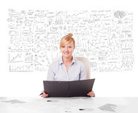 Pretty businesswoman planning and calculating various business i Royalty Free Stock Images