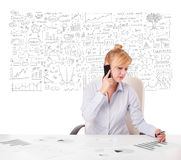 Pretty businesswoman planning and calculating various business i Stock Image