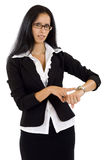 Pretty businesswoman pointing on watch Stock Photography