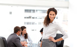 Pretty businesswoman presenting her team working Royalty Free Stock Photo