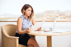 Pretty businesswoman reviewing documents Stock Photo