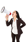 Pretty businesswoman shouting with megaphone Royalty Free Stock Images