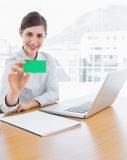 Pretty businesswoman showing green business card Stock Photos