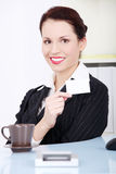 Pretty businesswoman showing white card. Royalty Free Stock Photography