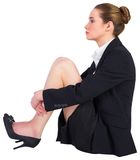 Pretty businesswoman sitting on floor Royalty Free Stock Photo