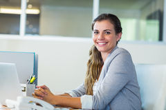 Pretty businesswoman smiling at camera Stock Images