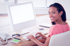 Pretty businesswoman smiling at the camera Stock Photo