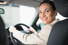 Pretty businesswoman smiling and driving Stock Photography