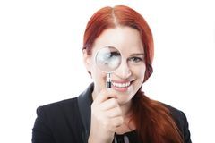 Pretty Businesswoman Spying with Magnifying Glass Stock Photo