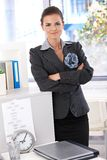 Pretty businesswoman standing arms crossed Royalty Free Stock Photo
