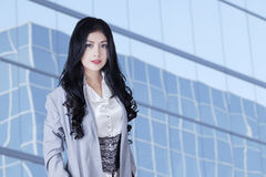 Pretty businesswoman standing outside Stock Photos